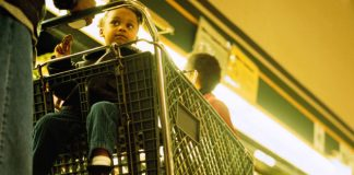 child in shopping cart