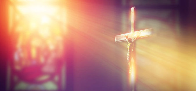 light shines on crucifix