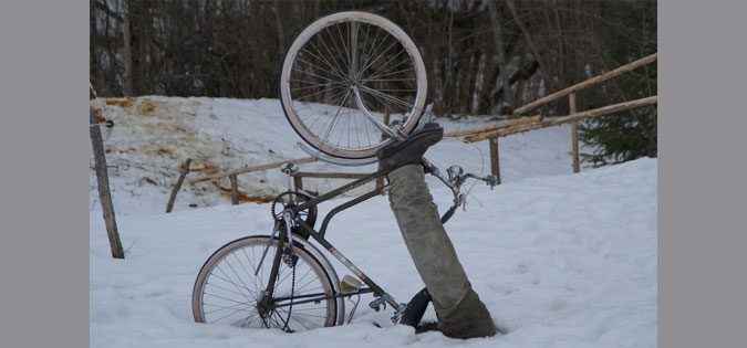 person and bike stuck in snow