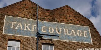 """Take Courage"" painted on building - image by Nick Webb under CC BY 2.0"