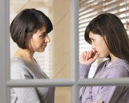 woman comforting young girl