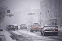 cars driving through the snow