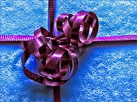 gift tied with purple ribbon