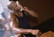 man wiping sweat from face