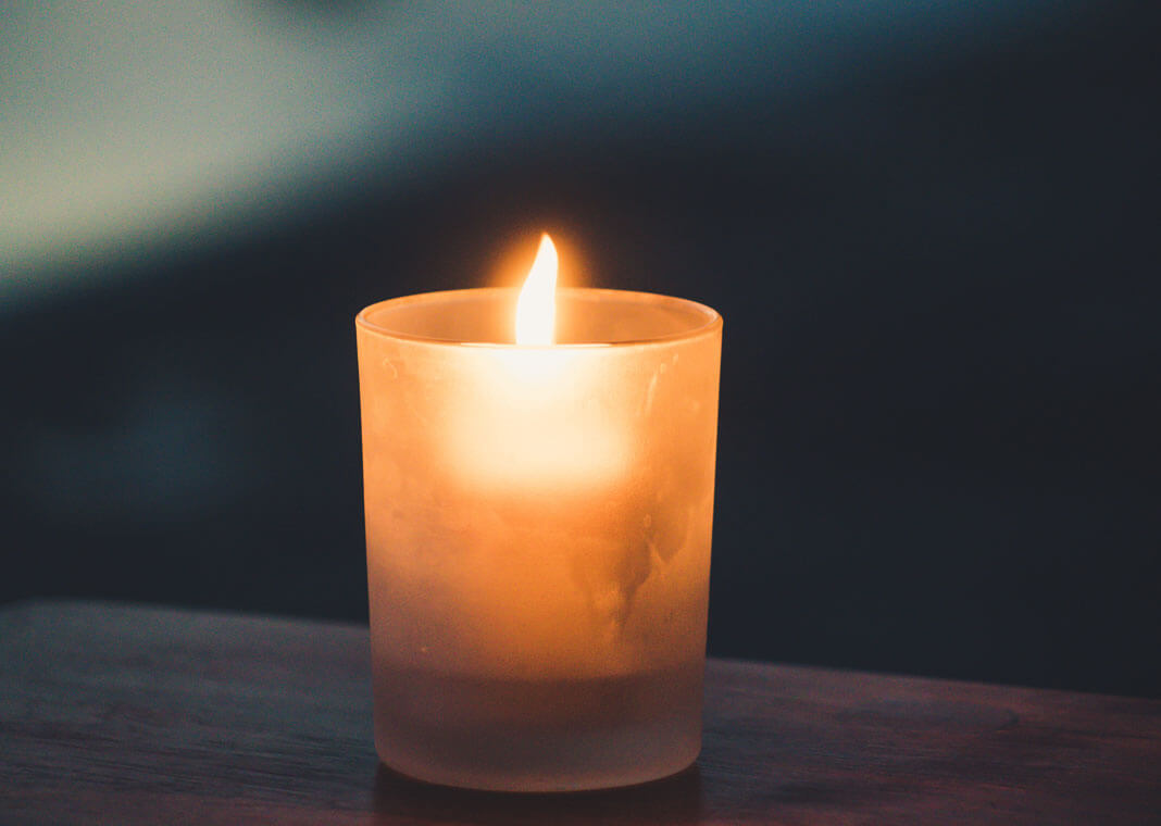 candle - photo by Paolo Nicolello on Unsplash