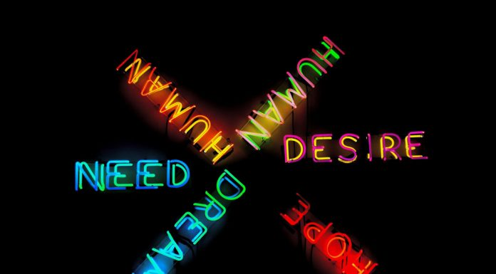 neon signs that read: human desire need dream and hope - photo by Alexis Fauvet on Unsplash