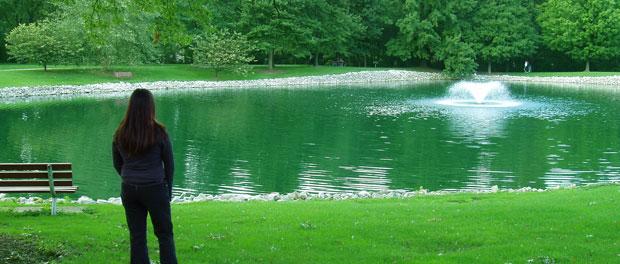 reflective woman at park