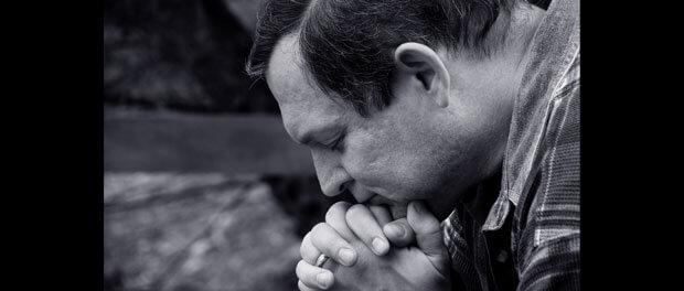 man in silent prayer