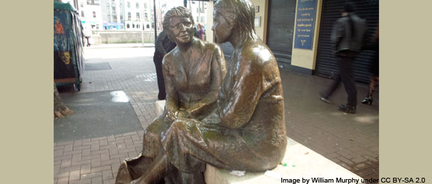 statue of women talking - photo by William Murphy under CC BY-SA 2.0