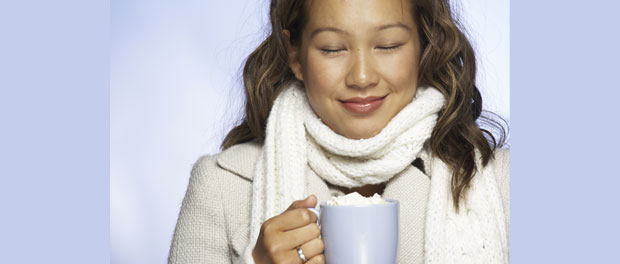 woman enjoying hot chocolate