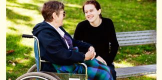 intergenerational friends talking in the park