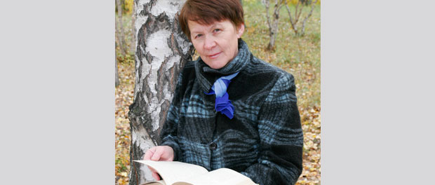 woman outdoors with book
