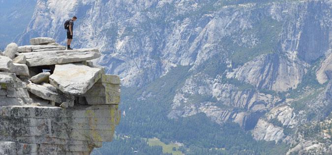 man standing on rock