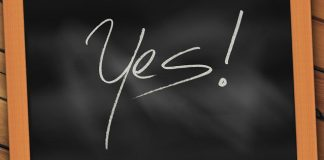 """word """"yes"""" written on a chalkboard"""