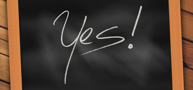 "word ""yes"" written on a chalkboard"
