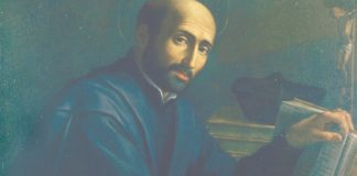 St. Ignatius Loyola sitting at his desk