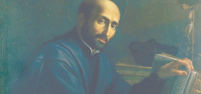 St. Ignatius Loyola sitting at his desk