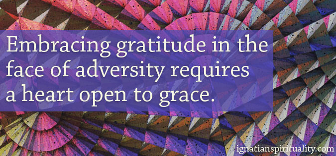 Text - Embracing gratitude in the face of adversity requires a heart open to grace. - on background of shapes
