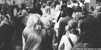 stillness in sea of people