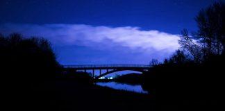 dark sky over bridge