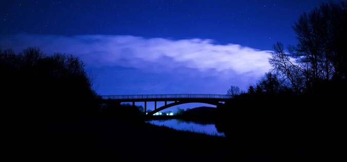 dark sky over bridge