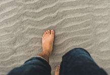 barefoot on beach - photo by Clint McKoy on Unsplash