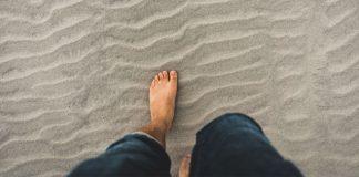 barefoot on beach - photo by Clint McKoy on Unsplash