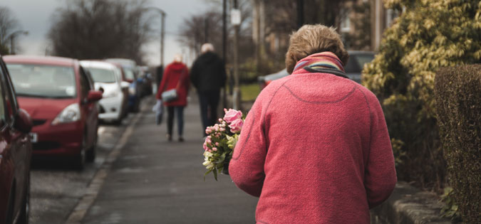 woman walking with flowers