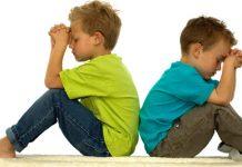 boys sitting in silent prayer