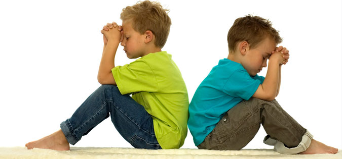 boys sitting in silent prayer
