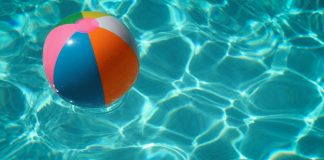 beach ball in swimming pool - photo by Raphaël Biscaldi on Unsplash