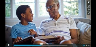 screenshot of elderly man with grandchild sharing a memory