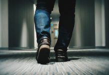 man walking in hallway - photo by Farrel Nobel on Unsplash