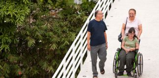 5 Gifts of Ignatian Spirituality for the Aging - text over image of people walking on bridge