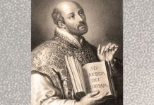 St. Ignatius with AMDG in book