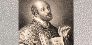 St. Ignatius with AMDG in book