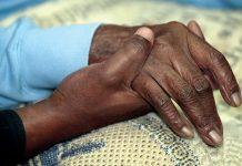 holding hand of an elder