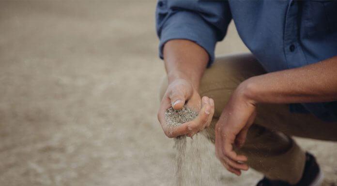 sand running through fingers - photo by Forrest Cavale on Unsplash
