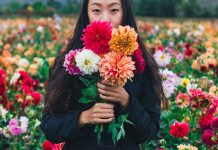 woman with flowers - photo by Remi Yuan on Unsplash