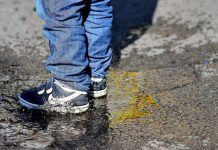 child standing in puddle - image by Lutz Holzapfel from Pixabay
