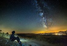starry night with young man pondering in silence