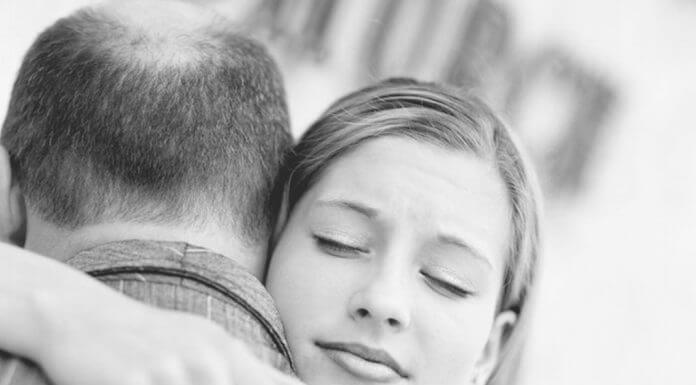 young woman hugging her father