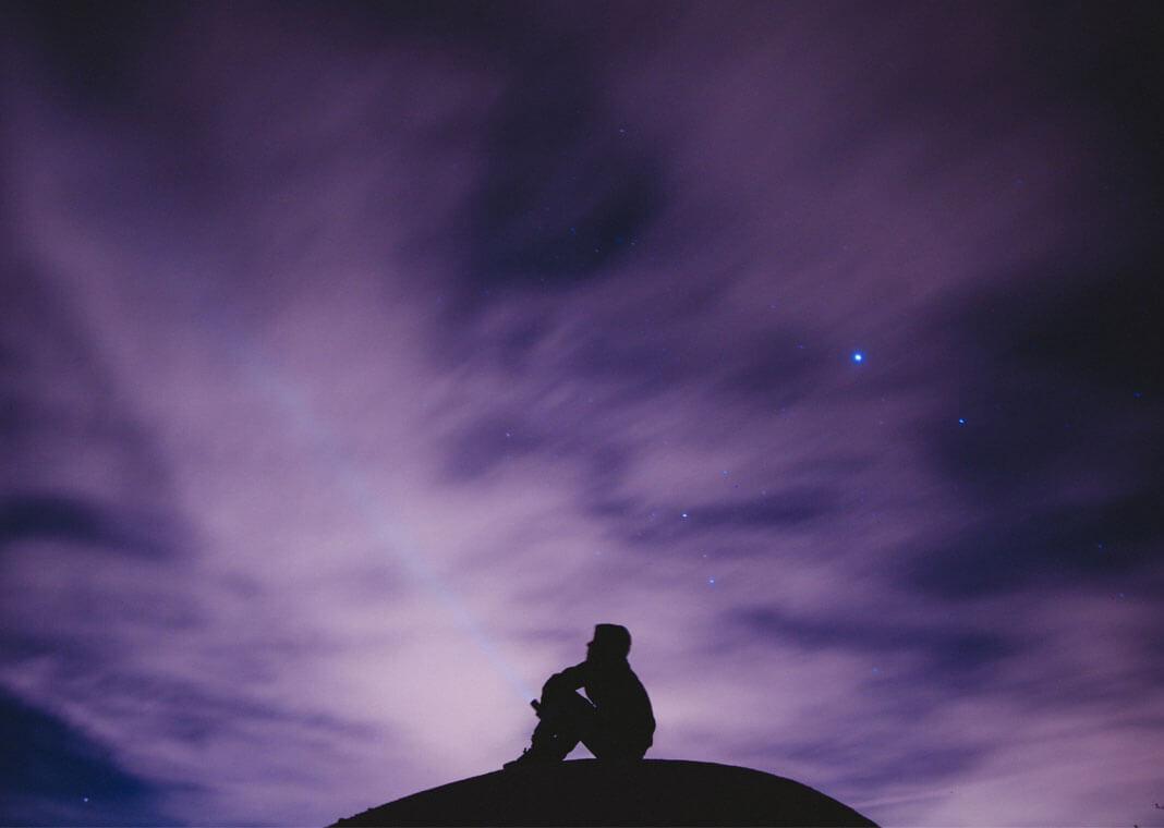 person sky gazing at purple sky