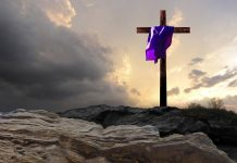 purple-draped cross