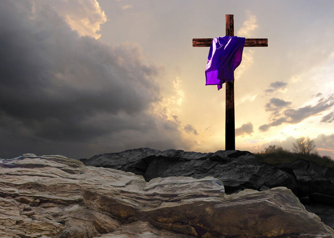 purple-draped cross