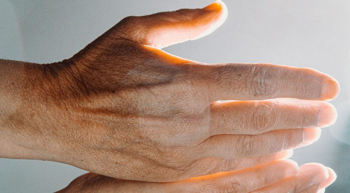 open hands - photo by Ave Calvar on Unsplash