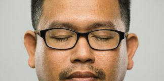 man with glasses listening
