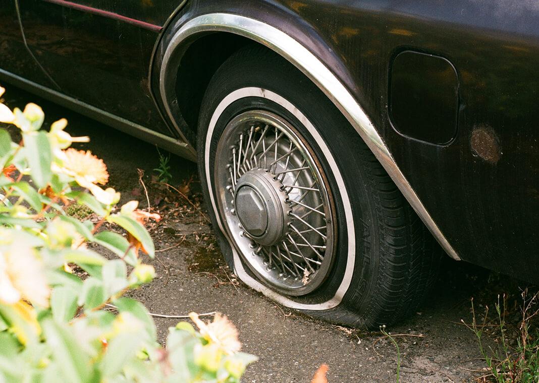 flat tire - photo by Sebastian Huxley on Unsplash