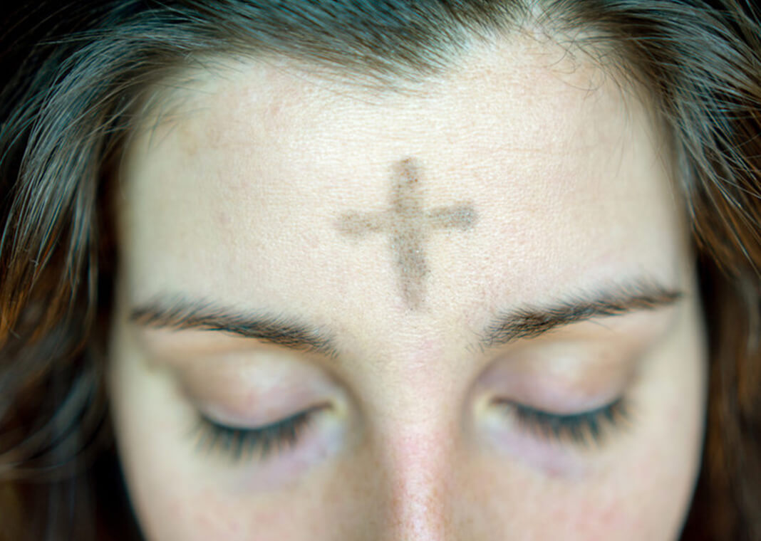 ashes on woman's forehead