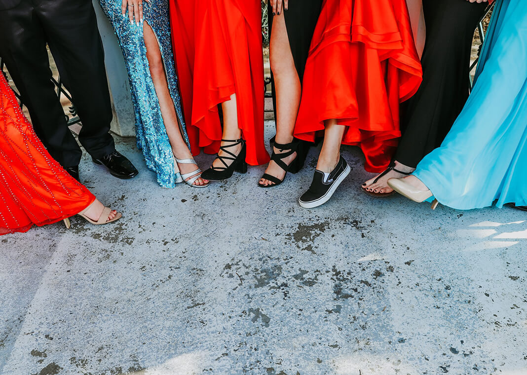 prom goers showing off footwear - image by chelseighmillar from Pixabay